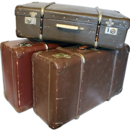 three old stacked suitcases