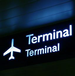 sign to airport terminal