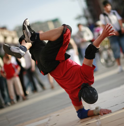 A youth somersaulting