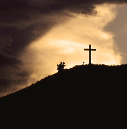 a cross on a hill