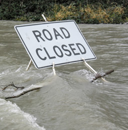 a road closed sign in a flood