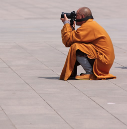Buddist taking a photograph