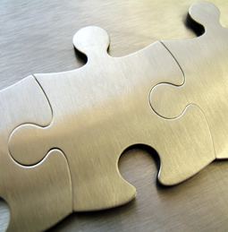 Three linked gold jigsaw pieces