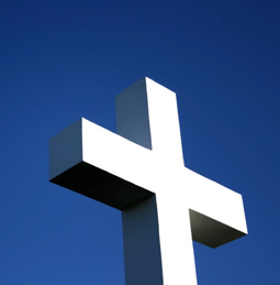 a white cross against a blue sky