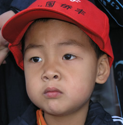 a Chinese boy wearing a cap